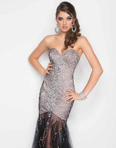 Blush Prom 9504 - Illusion rocks the party! Silver stones drape your silhouette as they flow into a sheer black runway skirt.  #prom