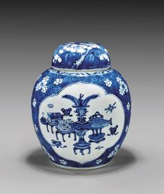 """KANGXI PERIOD BLUE & WHITE JAR & COVER Fine Chinese Kangxi Period, blue and white porcelain jar and cover; of well potted bulbous ovoid form, the body with two large shaped panels of precious vessels and scholarly emblems, reserved on a ground of plum blossoms; matching domed cover; H: 8 1/8"""""""