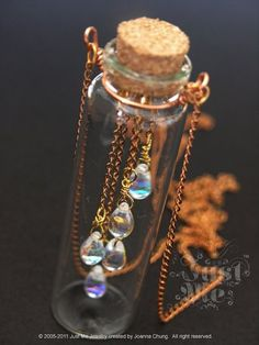 I am obsessed with the beauty of rain drops, dew and mist. It's been a while that we have a very humid weather in Hong Kong. It's dripping everywhere and the humidity is 100% almost everyday! It's our typical spring season! Read more... http://www.artfire.com/ext/shop/product_view/JustMeJewelry/7784904/just_me_-_spring_rain_glass_bottle_necklace_30_inches/handmade/jewelry/necklaces/locket