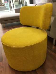 Fun & happy yellow chenille fabric for our smallest armless swivel chair.