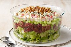 Sweet red grapes, tart apples and creamy blue cheese help make this crowd-pleasing layered salad as flavourful as it is beautiful.