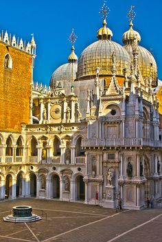The courtyard inside the Doge's Palace, in Venice, with the domes of St Mark's Cathedral peering above the rooftops.