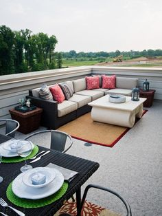 The outdoor sectional sofa on this terrace is ideal for gathering with guests or stretching out with the Sunday paper. A scrolled cocktail t...