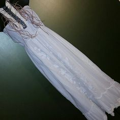 Boho maxi dress Strapless 100% cotton gauze, elastic smocking at top, embroidered roses down the front, bottom ruffle with macrame lace trim. EUC. See separate listing for necklace Mercer & Madison  Dresses Strapless