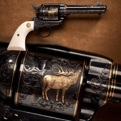 Engraved Colt Single Action Army - This engraved Colt Single Action Army revolver from the Petersen Gallery makes at least one member of our museum staff feel like he's back in the Big Horn Mountains of Wyoming. Up nearly two miles high, you can see elk like the inlaid gold example on this revolver's cylinder bugling next to crystal clear streams.