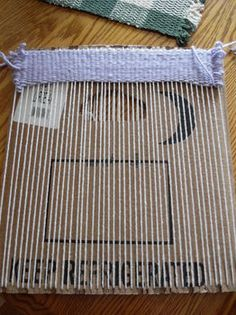 Homemade loom for all you weavers out there. Easy way to make your own small rugs out of old t-shirts or other fabric.