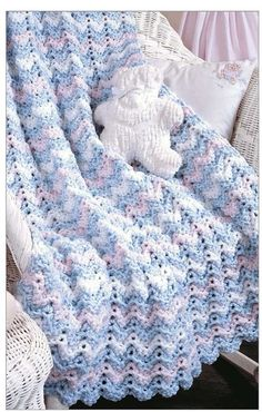 Crochet a blanket for the new baby with this beauty. The Little Encyclopedia of Baby Blankets