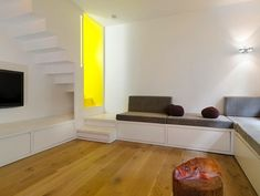 colors- white/grey & light wood floors. Brightens up the basement.