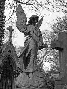 Angel sculpture in Pere Lachaise Parisian cemetery.