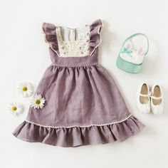 Pre-Sale: ShipsLate March* *Select USPS PriorityShipping for delivery by Easter Our dreamy Flutter Dress in Lavender Linen is a dream come true for every little girl. Lightweight linen in soft lavender twirls beautifully as she frolics freely. The sleeves and hem are generously ruffled to give a nice body to the dress, whilethe edges are adornedwith an ivory crochet trim. The yoke and back sashfeature a rarecottondouble gauze that has the most delicate vintage floral print. Bodice is…