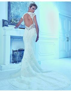 Lace fit n flare with keyhole back available at Spotlight Formal Wear! #SpotlightBridal