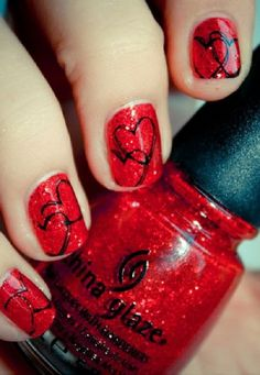 Heart on red glitter nails for Valentine's Day