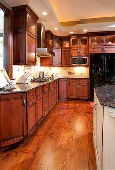 Mullet Cabinet   This Traditional Kitchen Features Birch Cabinets With A  Glaze Finish And Granite Countertops