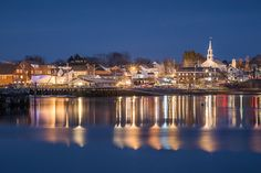 The town of Damariscotta is seen from Newcastle across the harbor. The town landing, downtown, and a classic white steeple can all be seen.
