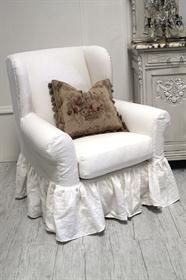 Linen Ruffle Slip Covered Wing Chair  fullbloomcottage.com  /////  I know just the chair in my house for this :=)