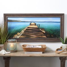 Sometimes we need an escape from reality. The 'Hues of Blue Framed Art Print' from Kirkland's is sure to let your mind wander! Imagine your legs hanging off a dock, resting in the peaceful bay, as a soft ocean breeze whispers in your ear... relax!