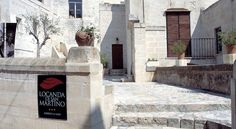 Locanda Di San Martino Hotel & Thermae Romanae Matera Locanda Di San Martino is set inside the Matera Sassi UNESCO World Heritage site. It offers traditional accommodation carved out of the rock, plus a hydromassage indoor swimming pool.