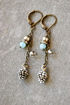 Winter pincone...  features antique brass leverbacks{ Lead and Nickel free}  light blue amazonite beads,vintage glass faux pearls,rhinestone