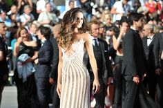 Dressed in a long white sheath dress, the top Izabel Goulart made a splash on the red carpet! #cannes #cannes2015 #cannesforever #CannesFilmFestival #franckprovostparis #franckprovost #tapisrouge #redcarpet