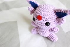 This Espeon amigurumi doll is approximately 3.5 inches (9cm) tall from the bottom of her body to the top of her head when finished.