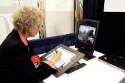Margaret Atwood autographs books remotely using her Long Pen. Would you go to an author signing where you saw an author on screen instead of in person?