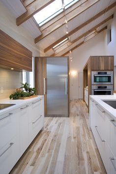 Love the mix of wood and white + the apparent ceiling | Cuisines Steam @cuisinesteam
