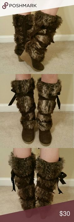 *FUR BOOTS ON A WEDGE HEEL* Sexy fur boots with a wedge heel. Can be worn over skinny jeans, with a skirt, over capri pants (tall enough that no one would know they weren't skinny jeans) or with shorts. Either way, they are extremely versatile! Delicately loved. STAY WARM! STAY SEXY! Shoes Winter & Rain Boots