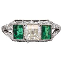 For Sale on - This ring features one square diamond in the center weighing carat approximately. The center diamond flanked on either side by rectangular emeralds Art Deco Jewelry, Jewelry Rings, Jewlery, Square Rings, Emerald Jewelry, Art Deco Diamond, Three Stone Rings, Platinum Ring, Fashion Rings