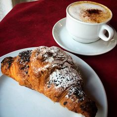 First order of business in Italy: devouring a cappuccino and a brioche - Instagram by globetrottergirls