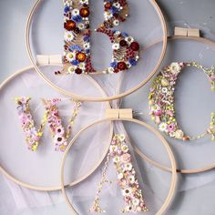Floral Wreaths Blossom Into Bold Type – In designer Olga Prinku's floral wreaths, hundreds of dried plants and flowers are sewn into the shape of large capital… Embroidery Hoop Art, Floral Embroidery, Flower Typography, Fleurs Diy, Flower Alphabet, Floral Hoops, Pressed Flower Art, Floral Letters, Arte Floral