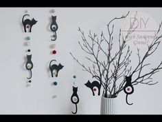 DIY - Hanging paper decorations with cats by Sostrene Grene.