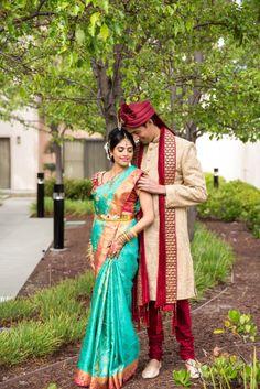 South Indian bride. Temple jewelry. Jhumkis.Teal blue silk kanchipuram sari with contrast pink embroidered blouse.Braid with fresh jasmine flowers. Tamil bride. Telugu bride. Kannada bride. Hindu bride. Malayalee bride.Kerala bride.South Indian wedding.