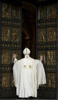 Pope Francis opens the Holy Door to mark opening of the Catholic Holy Year, or Jubilee, in St. Peter's basilica, at the Vatican