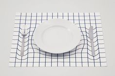 Tableware appears to sink into the table in the clever trick mat placemats created by Japanese design studio A.P.Works. The illusion is created through the distorted grid pattern silkscreened on th...