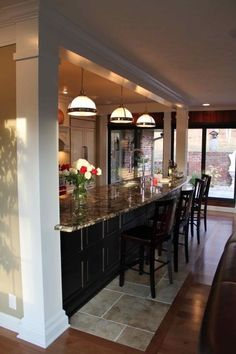 I love this 17' bar area separating the kitchen and dining room by maggie