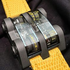 An industrial design with a zesty touch for this Cabestan Winch Tourbillon Vertical with a sandblasted titanium case and yellow markings and straps.