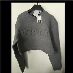 Alexander Wang x H&M neoprene cropped Sweater New with tags, a brand new, unused and unworn item. Still in bag. Original tags are attached along with specialty hanger. Fits larger as it's the style. Cropped. Alexander Wang Sweaters Crew & Scoop Necks
