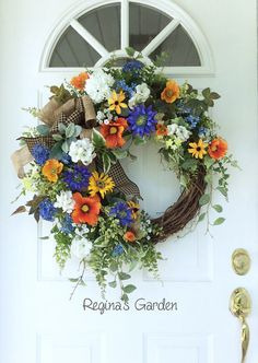Bright Summer Wreath-Summer Door Wreath-Cottage Chic Wreath-French Country Decor-Farmhouse Decor-Garden Wreath-Meadow Wreath This large, gorgeous wreath is filled with a collection of bright and cheery garden blossoms to welcome the arrival of summer. Bright orange poppies are mixed with Dutch asters, sunflowers, white geraniums, Black-eyed Susans, blue forget-me-nots, meadow flowers and flowering vines to create an eye-catching display for your door. A mix of garden ferns, ivy, pepper…