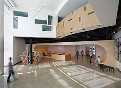 The entrance lobby at AOL's Palo Alto headquarters looks like a skate park  The skateboarding ramp spans the entire lobby and integrates a reception desk and a lounge area.