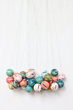 Handpainted wooden bead necklace by live.flourish.