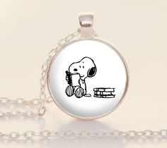 Reader Snoopy - Book Necklace - Bookish - Reading - Books - Reader Gift (B2030) by PaperHeartDaily on Etsy https://www.etsy.com/listing/207224863/reader-snoopy-book-necklace-bookish