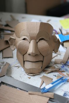 Cardboard mask for papier mache Cardboard Mask, Cardboard Sculpture, Cardboard Crafts, Paper Crafts, Painting Cardboard, Cardboard Spaceship, Paper Sculptures, Ceramic Sculptures, Halloween Nail Designs