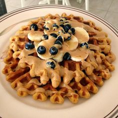 Protein Waffles! Recipe: 1/2 cup rolled oats, 1 scoop whey protein powder, 1/2 cup egg whites, 1 tbsp Greek yogurt or cottage cheese, 1/4 cup pumpkin puree (or other puree or additional cottage cheese), 1 tbsp stevia, 1 tsp cinnamon, and 1 tsp baking powder. Blend thoroughly! Mix should be thick but still pourable. Pour into greased/non-stick waffle maker and cook as usual ? I topped mine with Walden Farms maple syrup, peanut butter drizzle (PB2), bananas, and blueberries