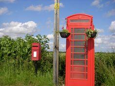 Witnesham, Suffolk phone box with flower baskets