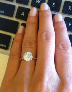 2.5ct (8.5mm) FB moissanite from MCo  Ring size 3.75.  Read more: http://boards.weddingbee.com/topic/show-me-your-2-25-carat-rings-please/#ixzz3VpYKS8R2