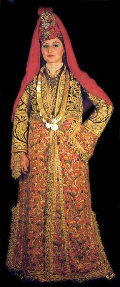 A traditional bridal costume from the city of Kütahya (West-Anatolia).  Late-Ottoman, 1850-1900.  The hand-embroidered fabric ('Tepebaşı') is characteristic of the town.