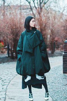 avant garde  Shirt by Marc Cain Vest by Jocomomola de Sybilla Skirt by Y's by Yohji Yamamoto Coat by Jil Sander Heels by Manolo Blahnik