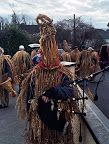 In Wren Day celebrations in Ireland, groups of Wren Boys (also called Strawboys or mummers) blacken or obscure their faces and dress in straw outfits or odd clothing. They carry an effigy of the wren or an actual live caged wren with them. Traveling from house to house, they ask for money to bury the wren in exchange for which they sing, dance and play music.