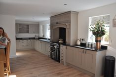Clients Stone Grey Ash Kitchen with Absolute Black Granite Worktops. Black Granite Kitchen, Grey Shaker Kitchen, Grey Painted Kitchen, Black Granite Countertops, Stone Kitchen, Black Kitchens, Kitchen Countertops, New Kitchen, Kitchen Interior