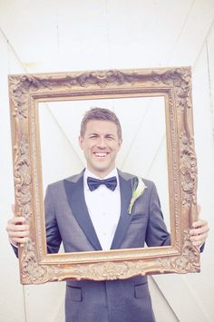 I love the idea of using an ornate frame or several of them for photos. I'd hang several different frames to create a photo set at your reception.     Photography By / http://maggieharkov.com,Floral Design By / http://narcissusflorals.com